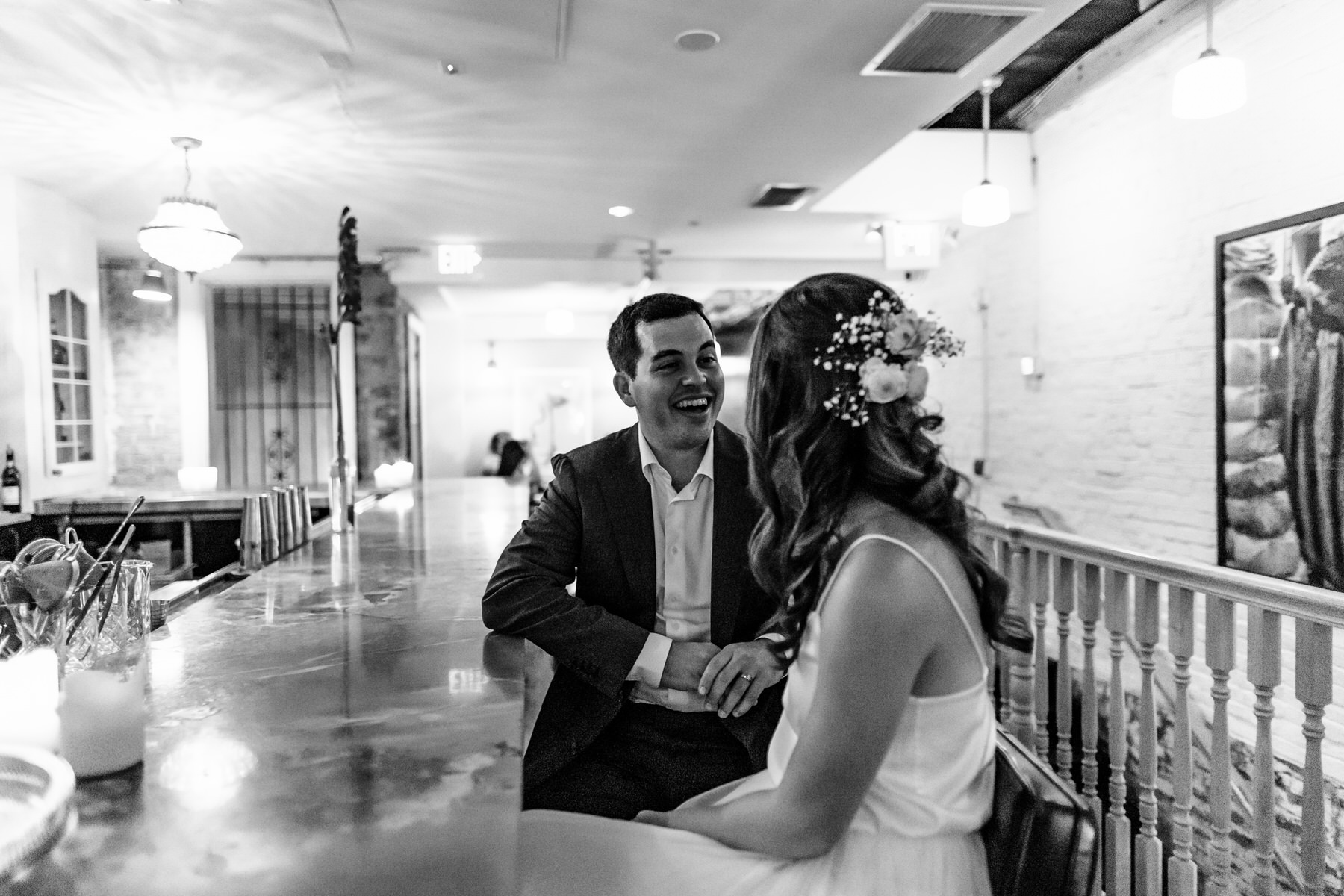 Rose's Luxury in Capitol Hill Wedding Reception Pic | A candid image of the groom and bride
