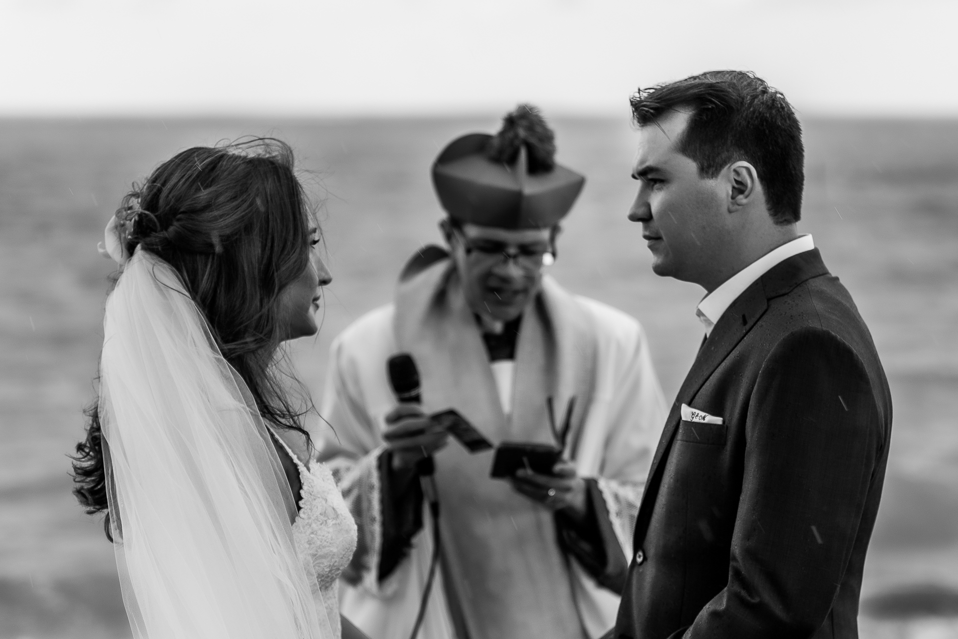 Pousada Reserva do Patacho wedding image from Brazil | the bride and groom  look into each others eyes in the midst of their wedding ceremony