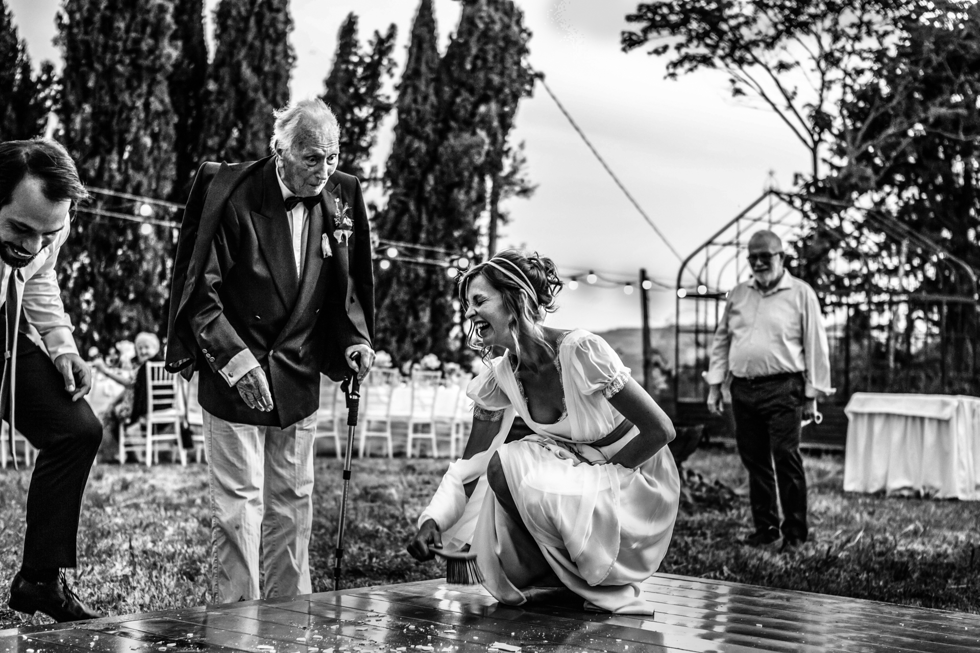 San Demetrio Weddings, Cesena, Italy | The bride laughs during the Slovakian tradition of the breaking of the plate