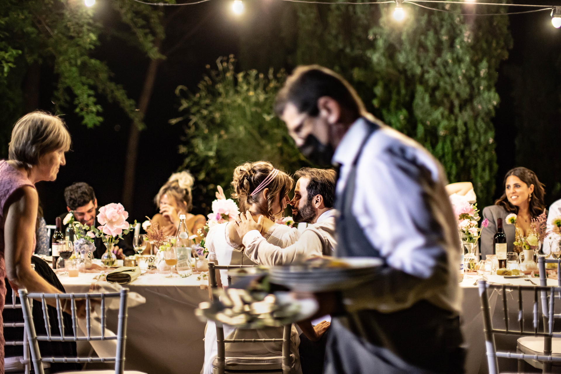 Wedding Reception Pic in San Demetrio - Cesena, Italy | the bride and groom are immersed in one another