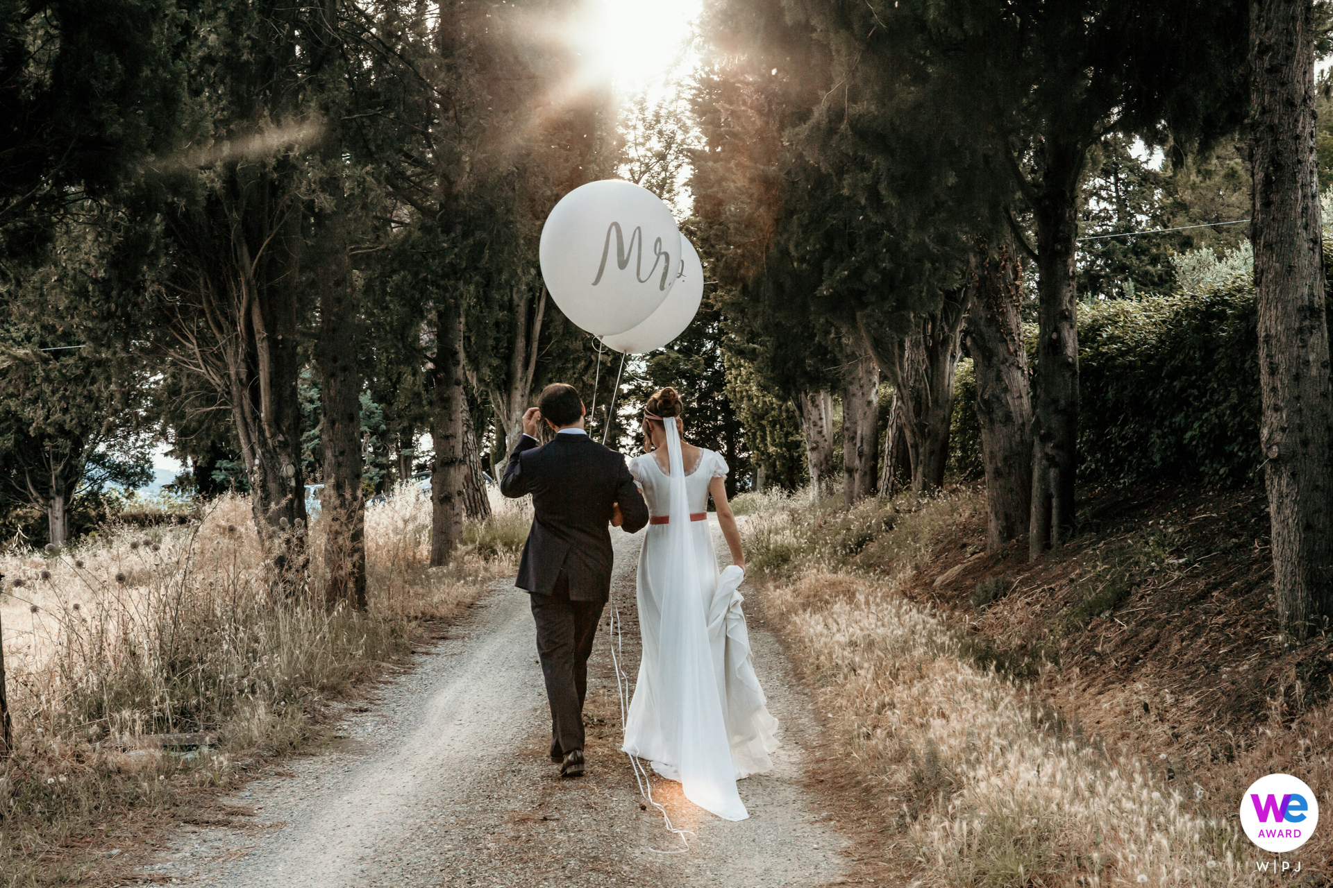 Destination Wedding Image of The bride and groom taking a peaceful stroll together after their ceremony