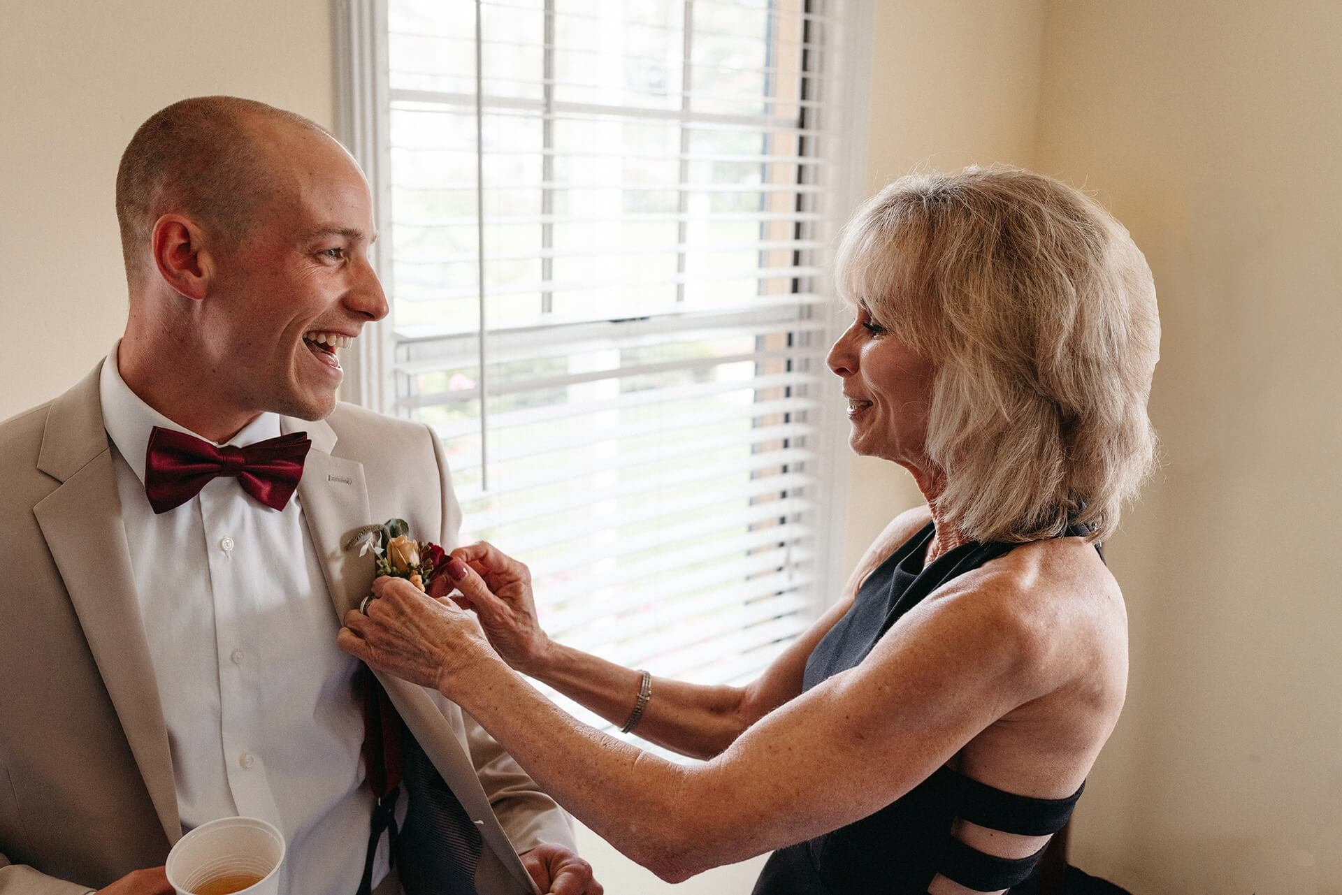 Northern California wedding photography   The grooms mother fixes his boutonniere