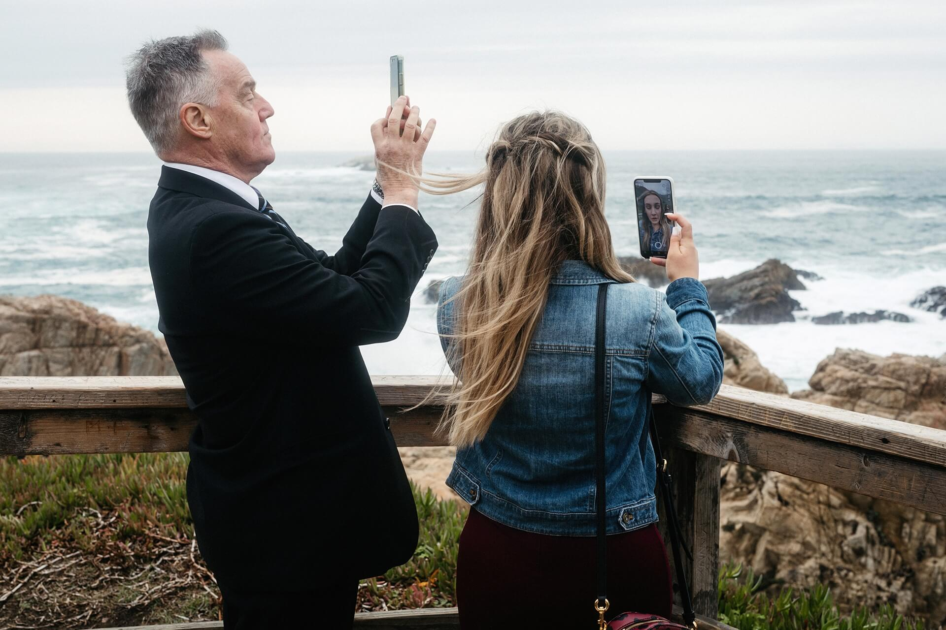 Big Sur California intimate wedding photography   The grooms father and sister take slightly different photos