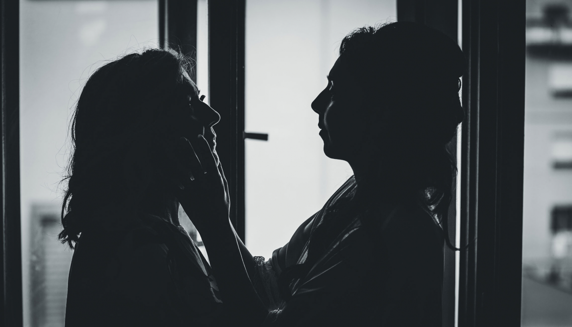 Photographer of Venice Italy Weddings | Mom is silhouetted during this moving moment in her parenting journey