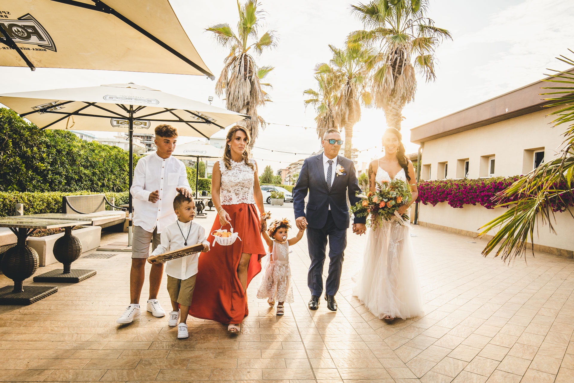 Wedding Photographer Venice, Italy in Chioggia | The bride clasps hands with her entire family