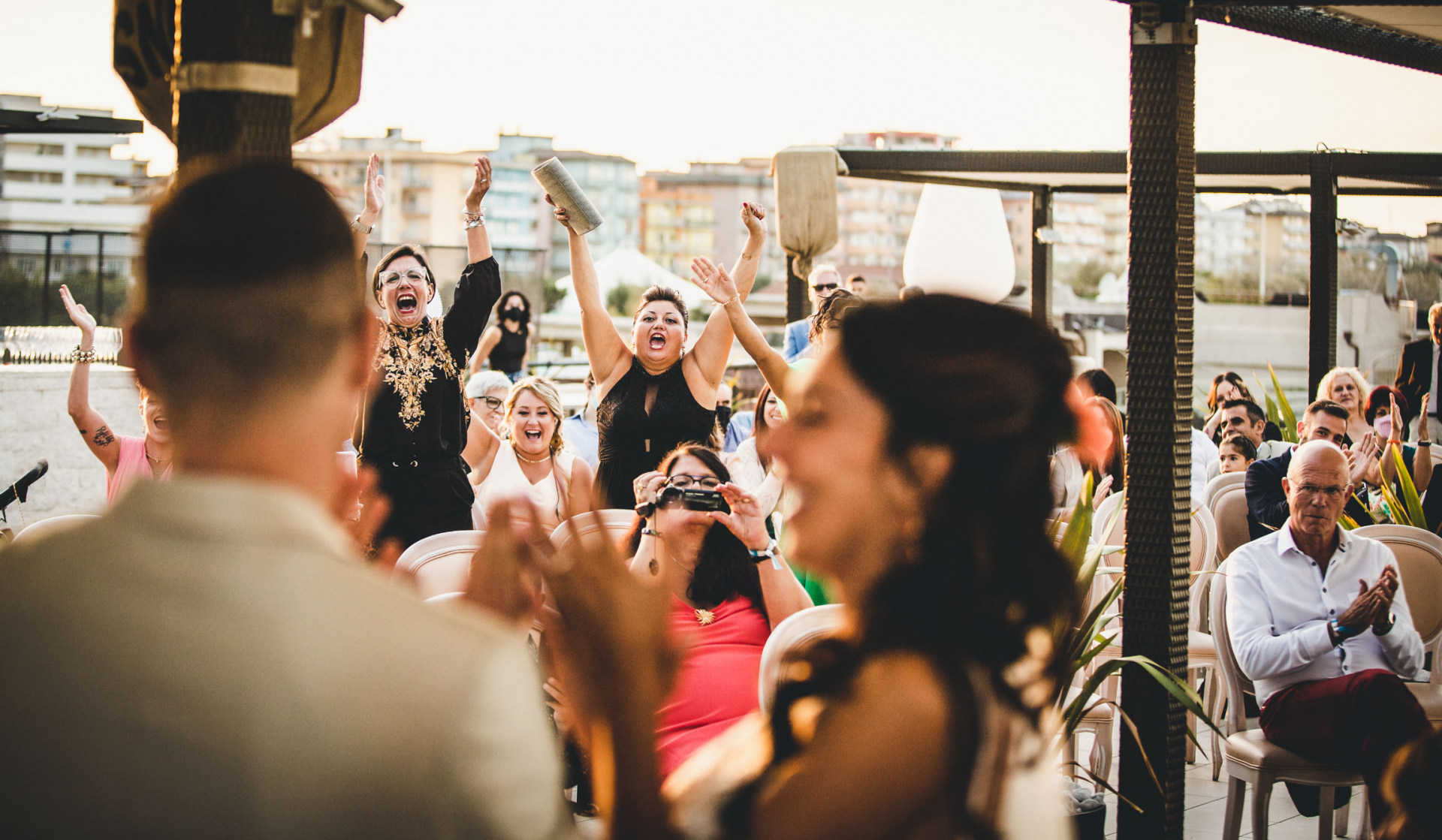 Outdoor Wedding Photographer of Venice | Guests are elated by the fact that the bride and groom are now officially husband and wife