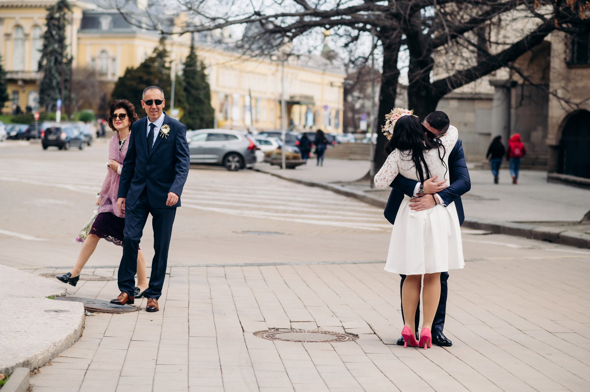Photographers in Sofia for Weddings | The bride and groom embrace on the street
