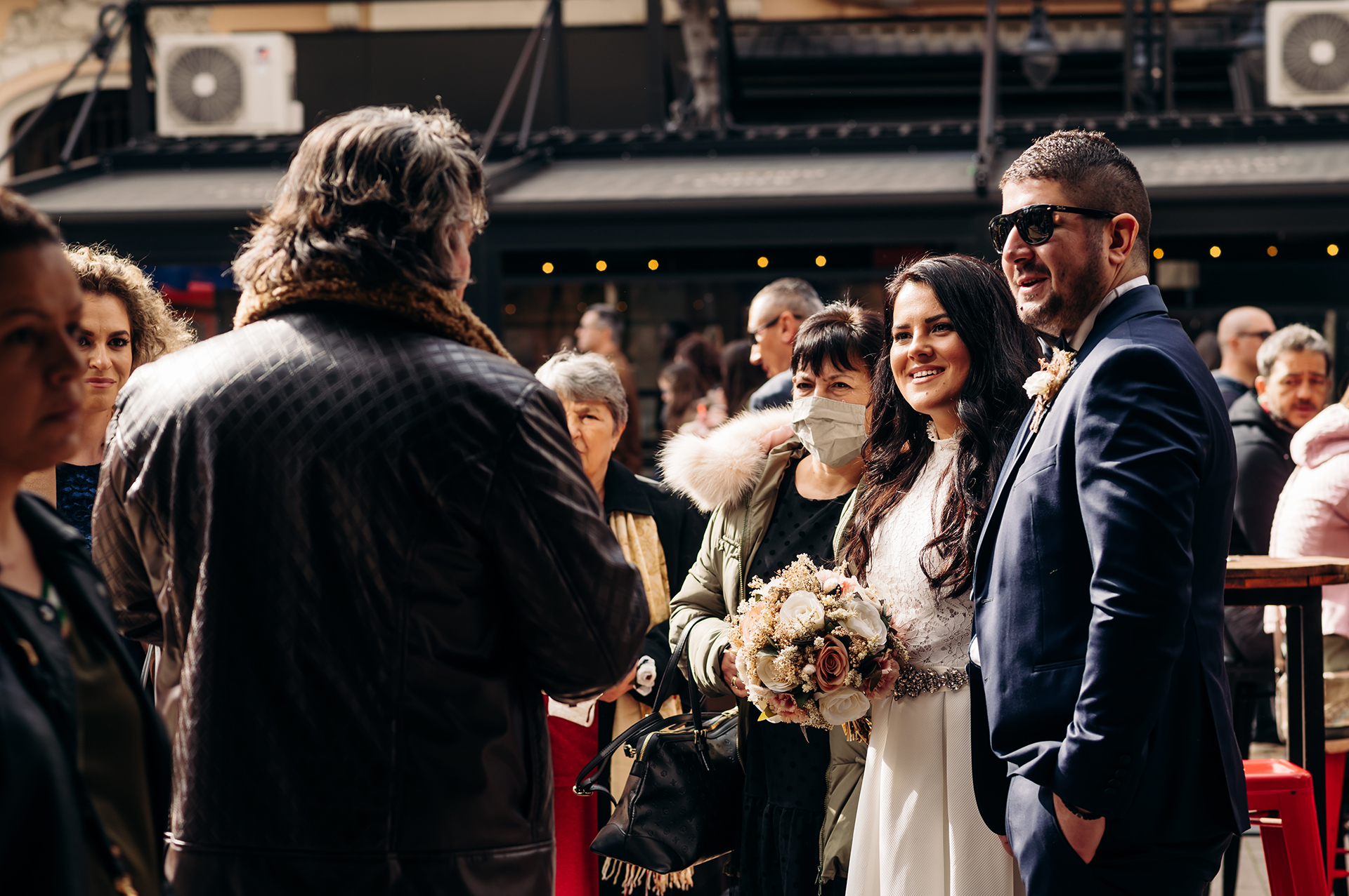 Wedding Photographer from Bulgaria | The bride and groom receive instructions from the man at the ritual hall