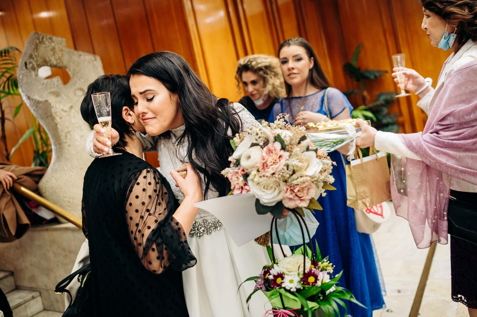 Sofia, Bulgaria - Ritual Hall Vitosha Wedding Image | The bride and her mother share a tender hug