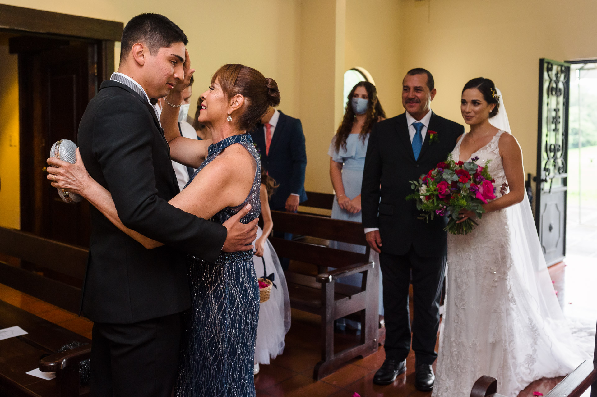 Wedding Photographer for Heredia, CR Ceremonies | mother give the groom a blessing