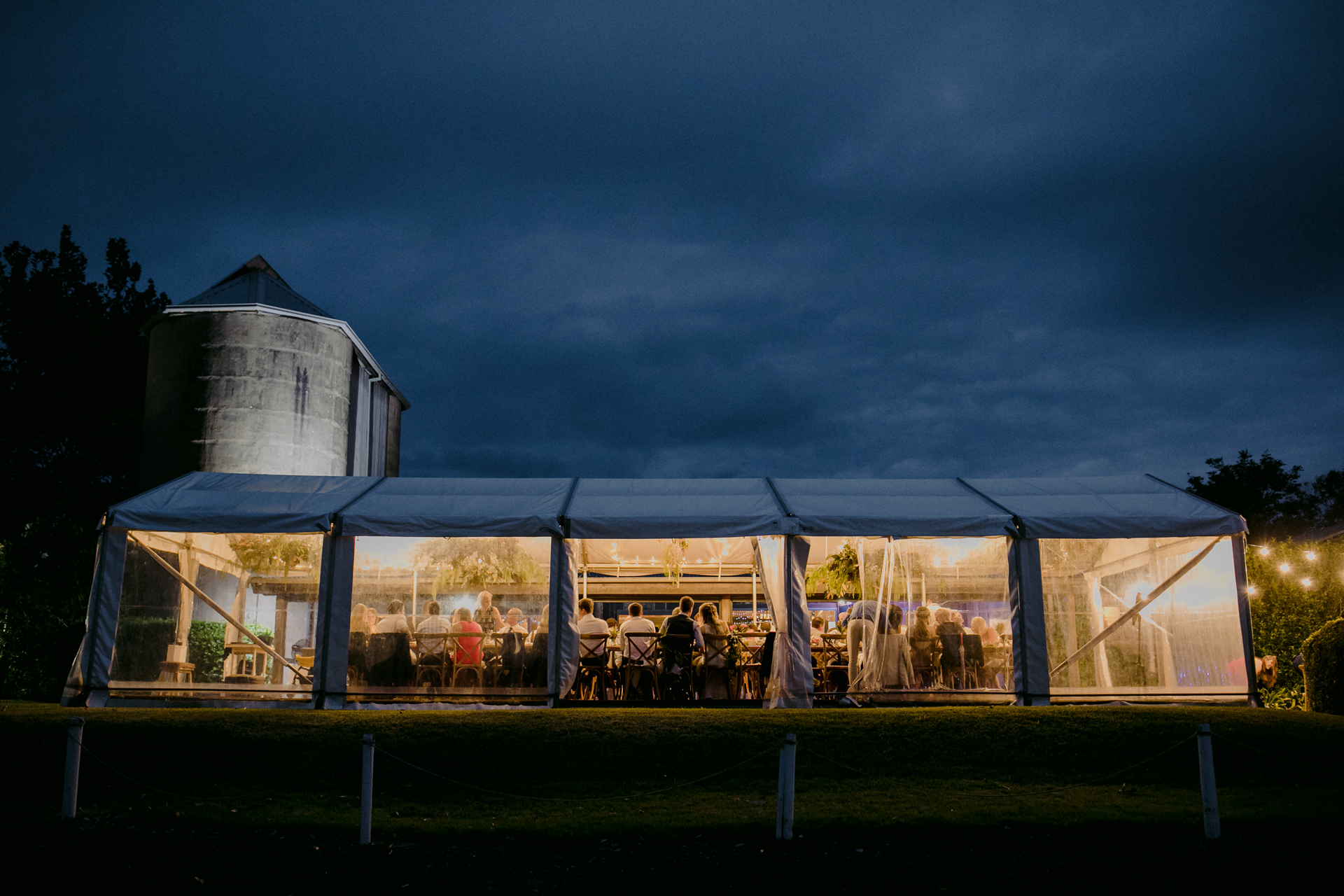 Wedding reception tent photography showing informal atmosphere