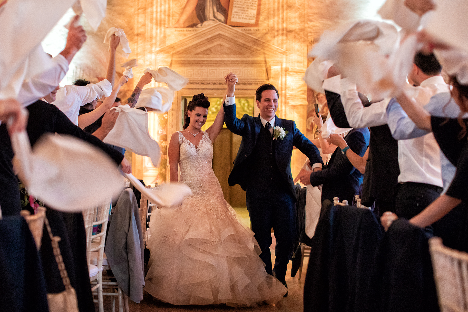 Candid wedding photography showing incredible entrance of the bride and groom to the dinner