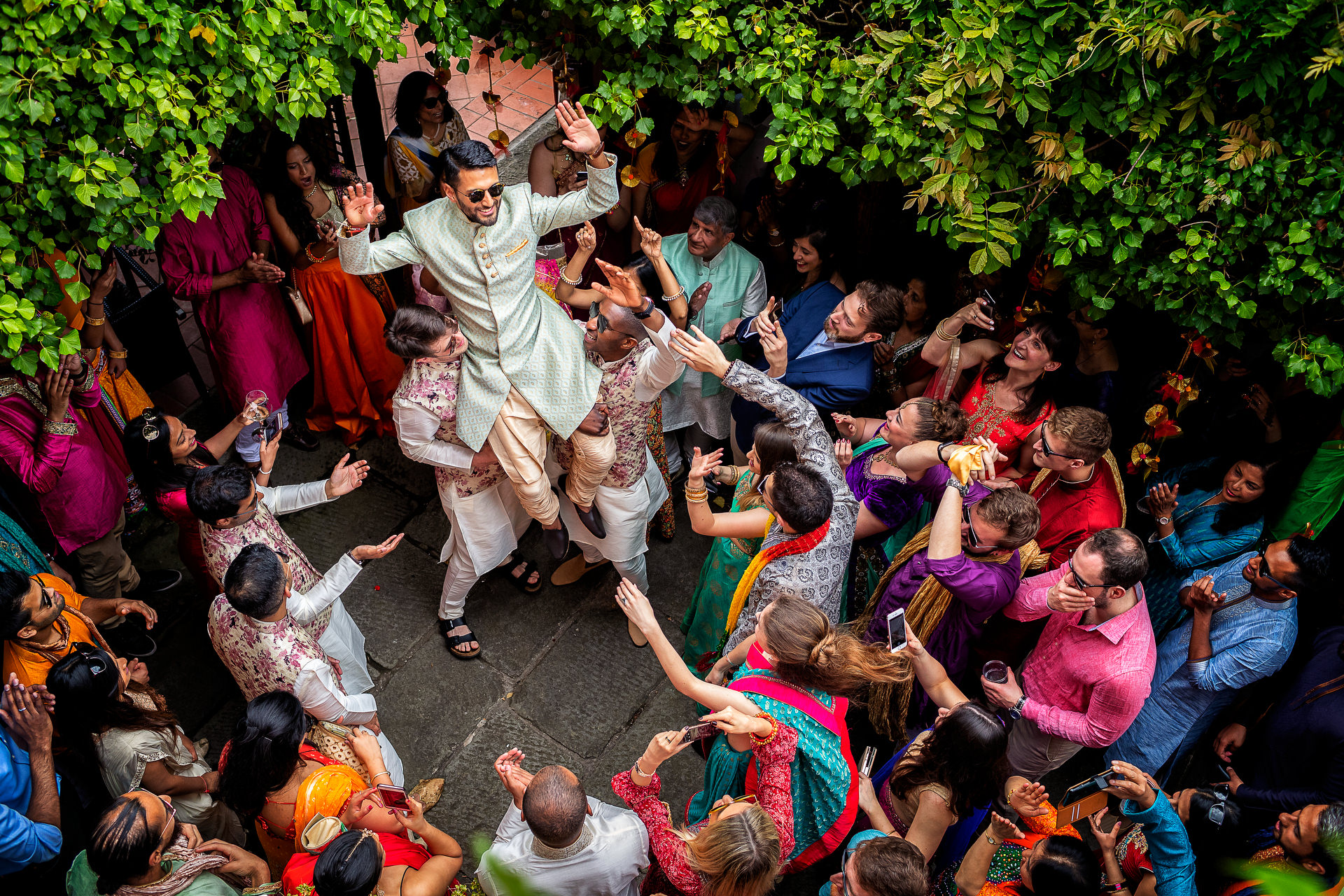 Wedding Photography of Indian traditional dancing with groom at a royal wedding fit for a king
