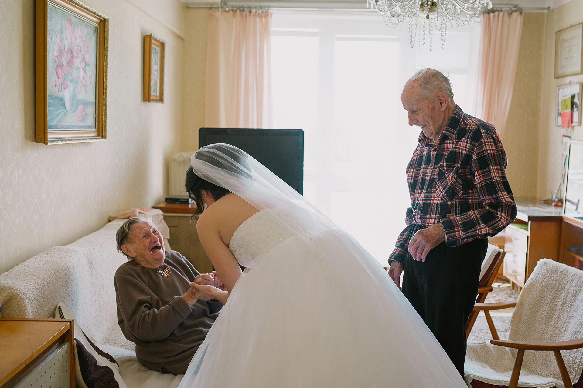 The Bride has a moment with her grandparents in this wedding day photograph.