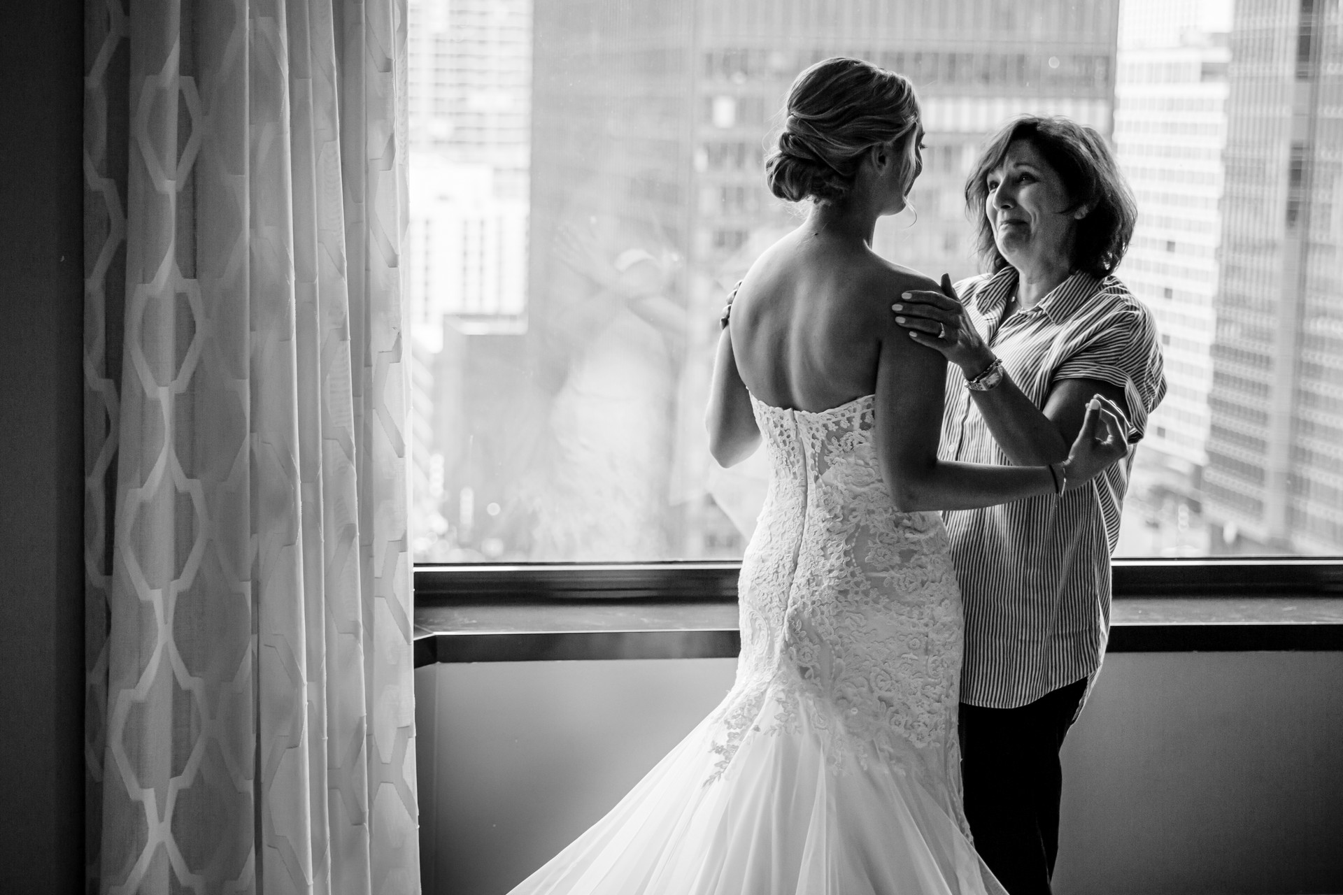 Anticipation of capturing a quiet moment between bride and mom - Wedding Photography Moments