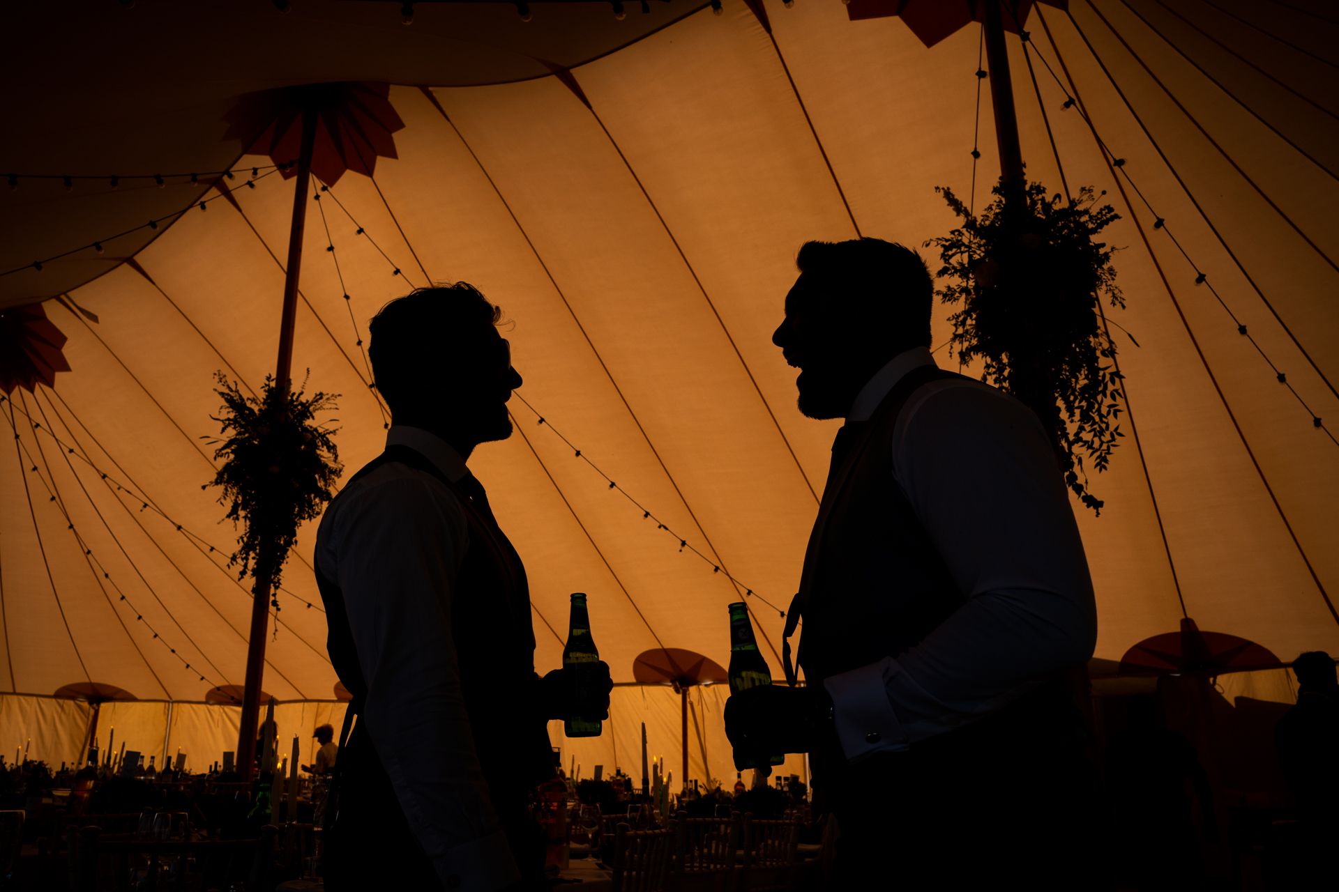 Wedding tent photos showing the contrasts with darker subjects, resulting in great visuals