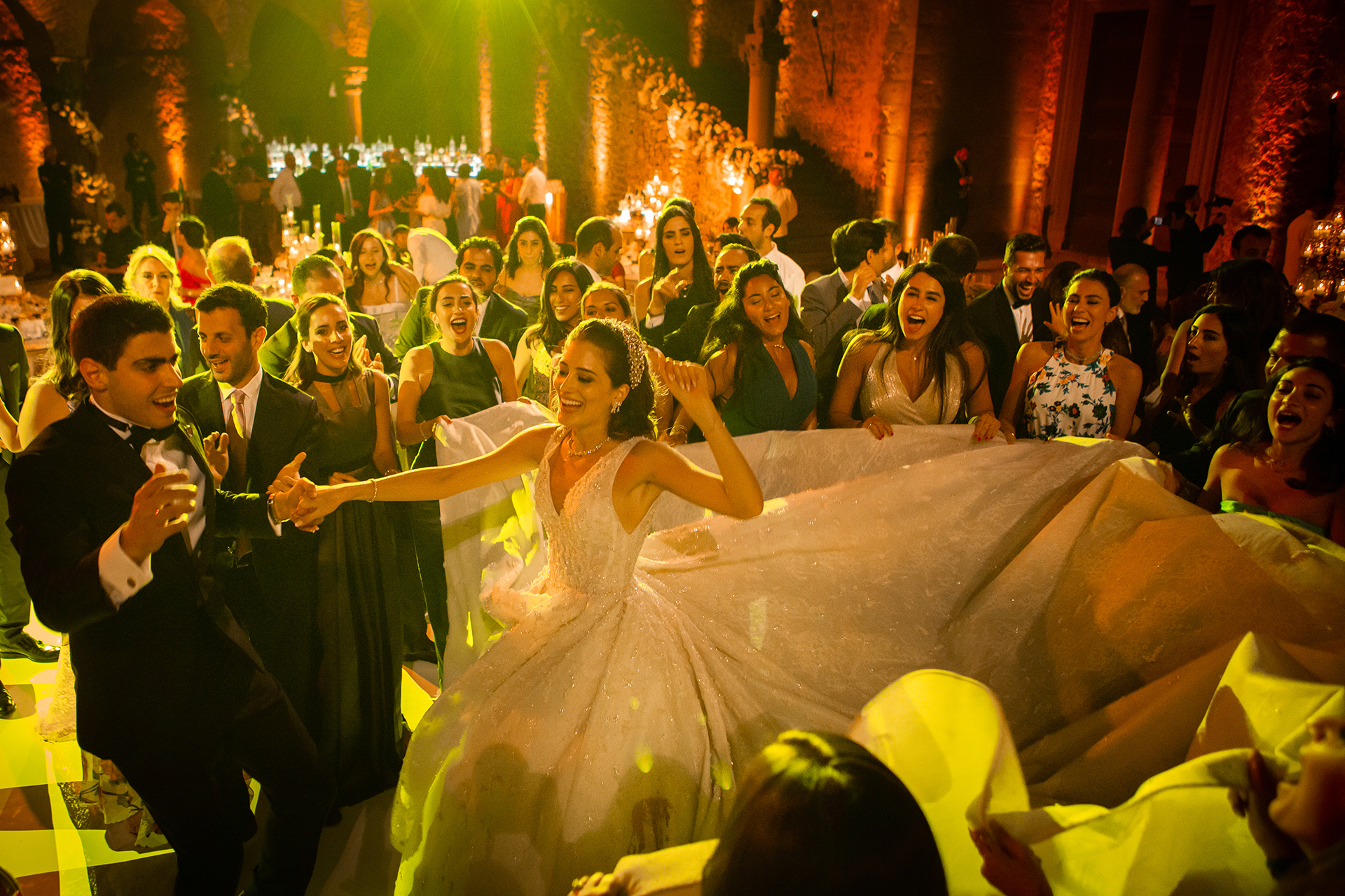 Photography of The party at the reception venue with the royal bride and groom