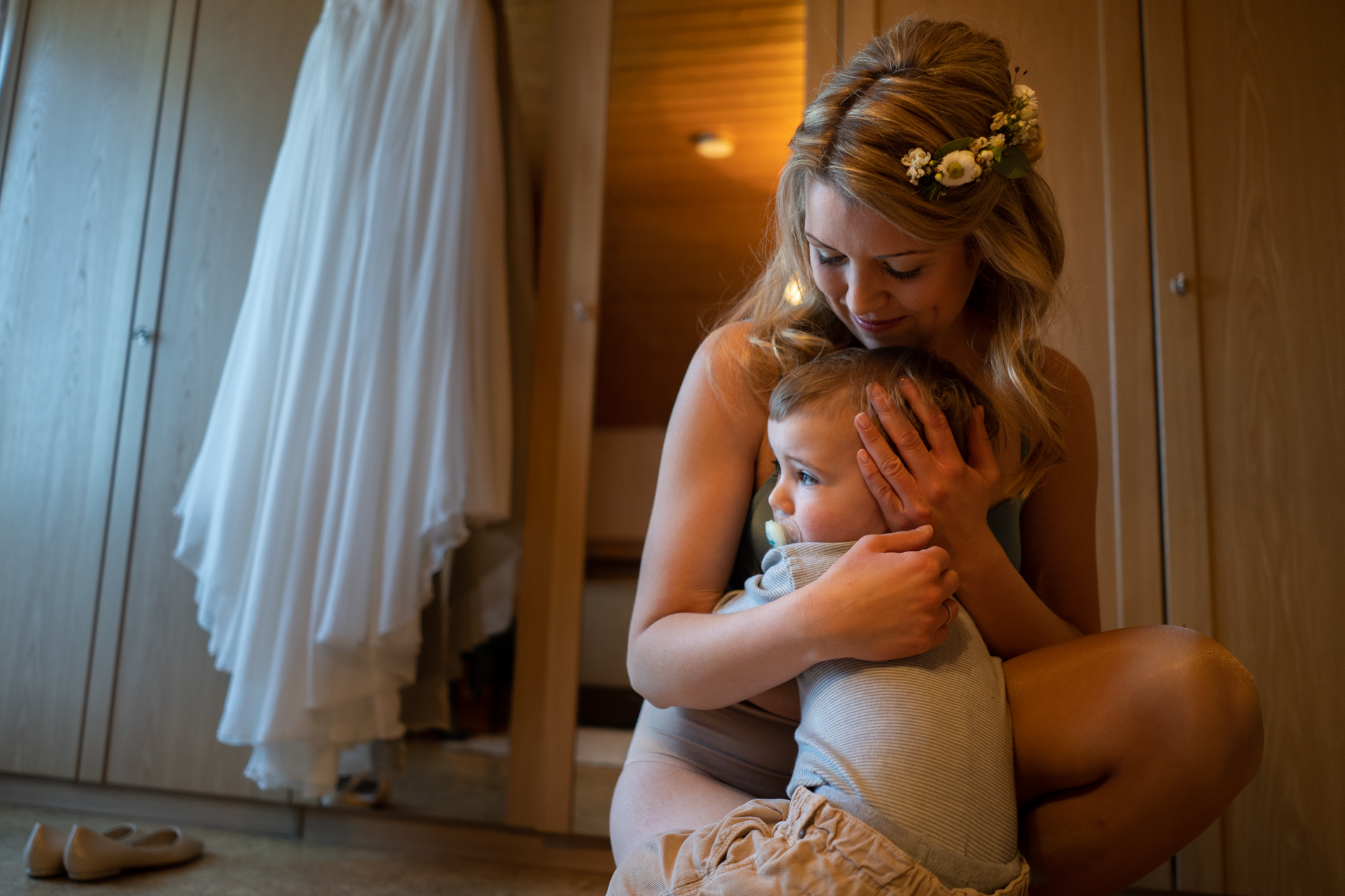 Wedding photo of emotional moment between mom and her kid.